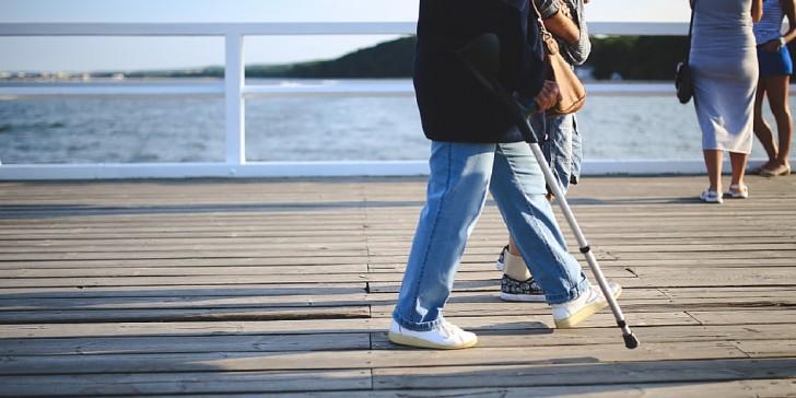 Person with crutch